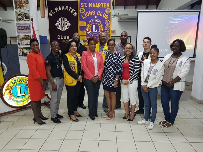 Minister Jacobs, President of the St. Maarten Lions Club Mr. Davey Woods, St. Maarten Leo Club Advisor Mrs. Lisandra Ellis-Havertong, the Division of Inspectorate team, Mr. Lenworth Wilson Jr., Mr. Marciano Geeerd, St. Maarten Leo Club members & Cabinet ECYS Policy Advisor Fabiana Vanterpool-Arnell.