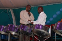 L to R, Minister Hon. Maurice Lake presenting the Mighty Dow Isidore York with the documents for the domain land to build the Steel Pan School.  DCOMM Photo