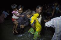 Many Rohingya refugees fleeing Myanmar arrive in Bangladesh under cover of darkness on wooden boats on the beach at Shah Porir Dwip, Teknaf, near Cox's Bazar. Photo: UNHCR/Roger Arnold