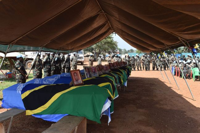 Ceremony in Beni, Democratic Republic of the Congo, paying tribute to the 14 UN peacekeepers who were killed during an attack on the UN mission's base in Semuliki. The fallen peacekeepers were praised for their bravery, courage and professionalism in carrying out efforts to restore peace in the territory. Photo: MONUSCO/Alain Coulibaly