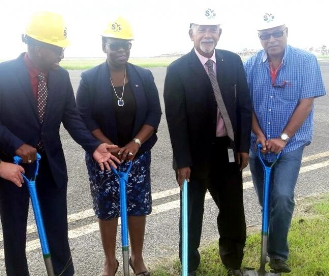 Minister Mellissa Arrindell-Doncher (center) with airport officials on Friday breaking ground for the new FBO facility.