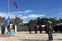 The UN flag is raised at the opening ceremony for the new United Nations Mission for Justice Support in Haiti (MINUJUSTH). Photo: Logan Abassi/MINUJUSTH