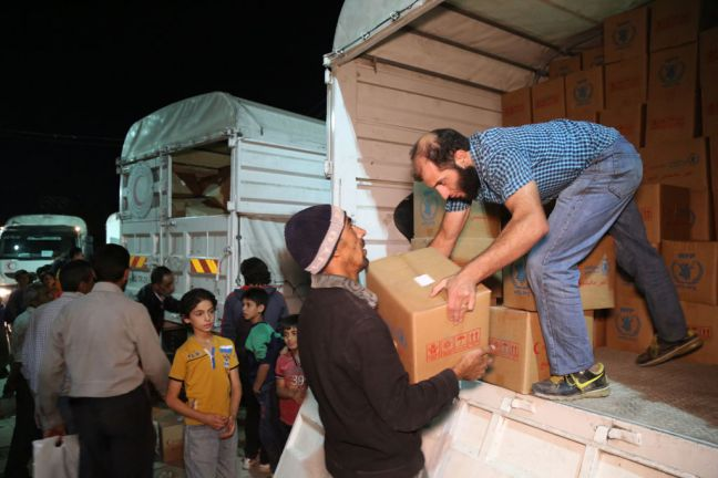 Humanitarian supplies are delivered in Madaya in Syria during a UN-interagency initiative to 'Four Towns' – Foah, Kafraya, Madaya and Az Zabadani – delivering urgently needed humanitarian assistance to 60,000 people. Photo: WFP/Hussam Al Saleh