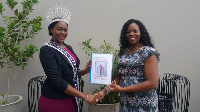 Miss Mature Queen 2016-2017; Norrisa Anatol hands over portfolio to Miss Mature Carnival Queen 2017-2018; Michelline Hunte. (Photo contributed)