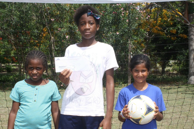 L to R, Mikaela Leblanc, Mikailie Carabin and Zara Buthrani with the check donated by GEBE.