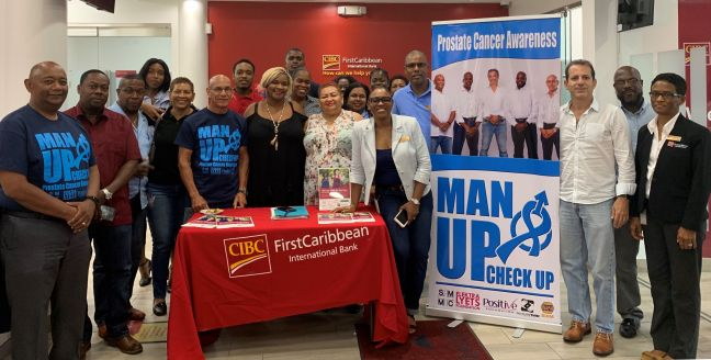 CIBC FirstCaribbean staff during the Hour of Hope session with prostate cancer survivor, Michael Ferrier.
