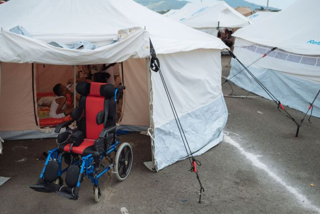 A 9-year-old disabled boy's wheelchair stands at the entrance of the tent where he and his family are living since the April 2016 earthquake destroyed their house in Portoviejo, Manabi, Ecuador. Photo: UNICEF/Santiago Arcos