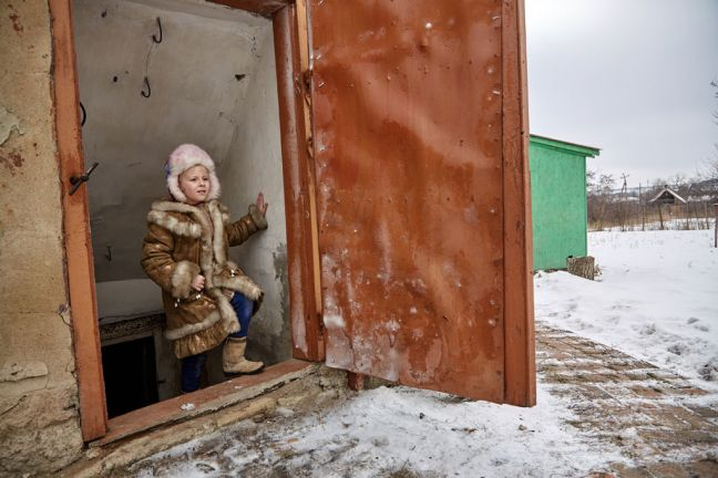 On 13 February 2017, when there seemed to be a pause in the shelling and fighting, Sasha, 6, carefully ascends the steep steps that lead outside of the cellar, about 15 kilometres from the contact line in Toretsk, Donetsk Region, Ukraine. Photo: UNICEF/Pavel Zmey