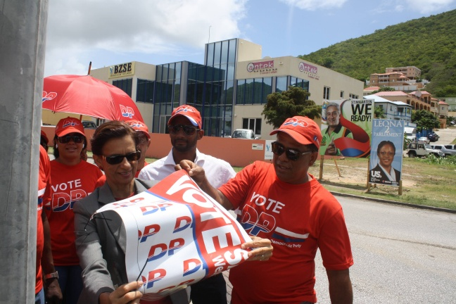 Prime Minister Hon. Sarah Wescot-Williams along with party supporters removing campaign materials near the Belair round-a-bout.