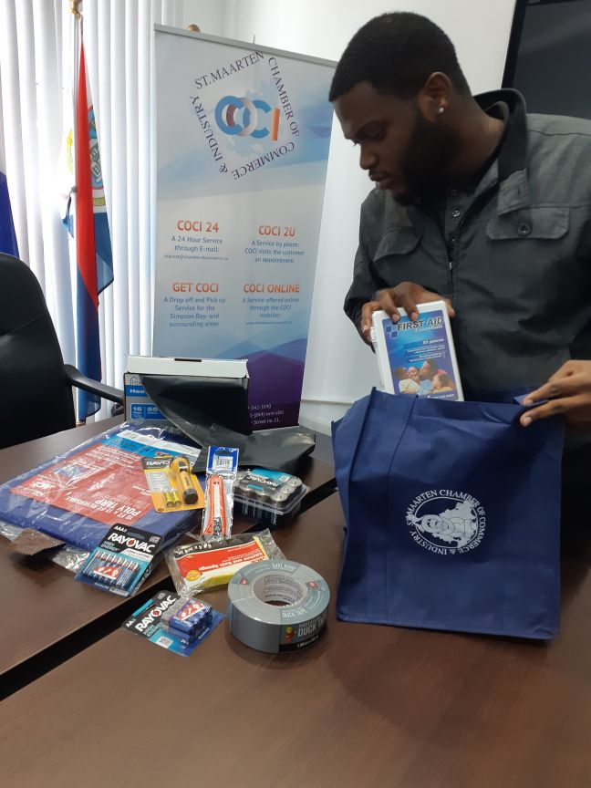 COCI staff member preparing a storm-ready go bag for the staff of the Chamber of Commerce & Industry.