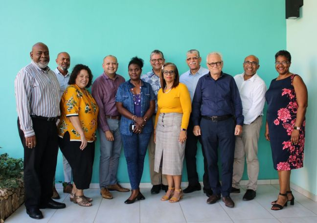 Education partners who have laid the foundation for Kibrahacha during the past year.  From left to right: Francis de Lanoy (rector magnificus University of Curaçao), Rensley Wanga (Dienst Openbare Scholen Curaçao), Nora Eleonora (Dienst Publieke Scholen Aruba), Berthson Boekhoudt (Instituto Pedagogico Arubano), Muriël Meyer (University of Curaçao), Glenn Thodé (rector University of Aruba), Nilva Wout (RK Schoolbestuur Bonaire), Canisio Wanga (bijzondere schoolbesturen Curaçao), Frans van Efferink (Scholengemeenschap Boniare), Antonio Baez (rector University of St. Martin), Marilyn Richardson (Instituto Pedagogico Arubano)