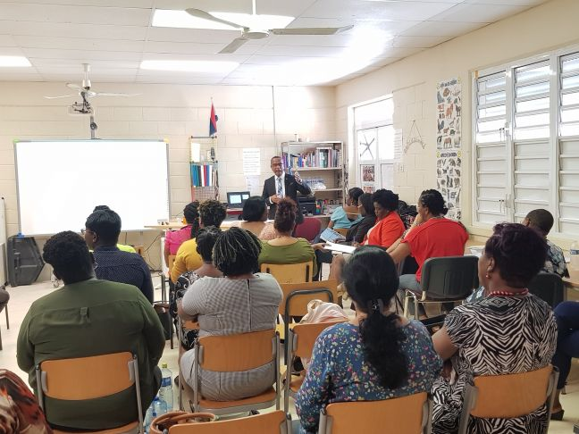 Minister Wycliffe Smith making his presentation to the staff of the Sint Maarten Vocational Training School on Wednesday.