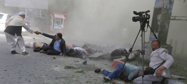 Reuters/Omar Sobhani A group of journalists and first responders are caught in a downtown Kabul suicide attack on 30 April 2018.