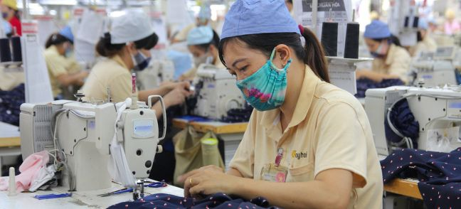 © ILO Women at work in a garment factory in Hai Phong, Viet Nam.