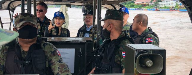 © UNODC The UN Resident Coordinator in Thailand, Gita Sabharwal (centre background) joins a patrol on the Mekong River.