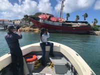 VROMI Inspectors on Nature Foundation Patrol Vessel Yellowtail documenting wrecked vessels.