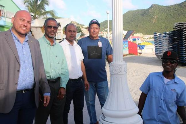 (Left to right) Minister of VROMI Christopher Wever, GEBE CEO Kenrick Chittick, GEBE Assistant Distribution Manager Patrick Drijvers, a GEBE supervisor and worker.