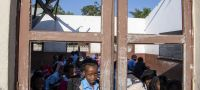 UN Photo/Eskinder Debebe Cyclones Idai and Kenneth in Mozambique. In Beira, a boy looks through a classroom window.