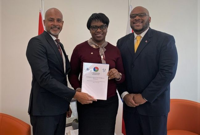 SER Chairman - Ir. Damien Richardson presenting the joint Migration Symposium report to Prime Minister Leona Romeo-Marlin and SER Secretary General - Gerard Richardson.
