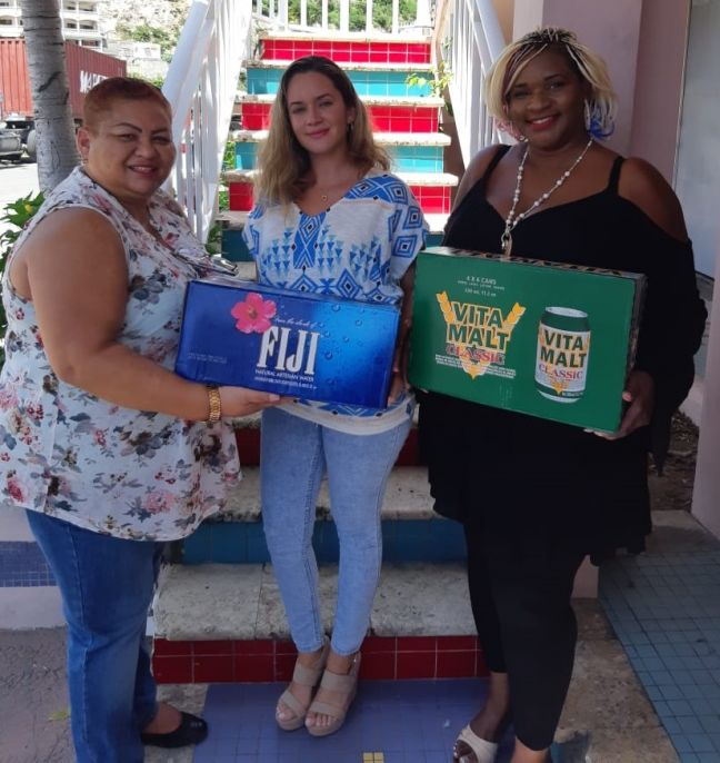 "L to R: Shelly Alphonso President Positive Foundation, Francine Chance Brand manager Fiji Water and Mercedes ""Elektra van der Waals –Wyatt President Elektralyets Foundation."