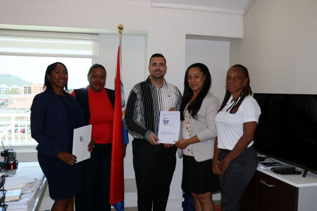 L to R: Mrs. Glennis Vlaun (Chairperson), Ms. Sophia Brown (Vice Chairperson), Honorable Minister of TEATT, Mr. Stuart Johnson, Mrs. Vincentia Rosen-Sandiford (Director) and Dr. Rhoda Arrindell (Member).