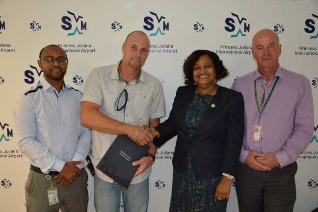L-R: Clifton Brown, SXM Special Projects Coordinator, Rob van Rooij, Managing Director of Rollfix Caribbean, Regina LaBega, SXM Managing Director and Max Schakel of SXM after the signing of the contract for the electrical installations at the new Cargo Building.