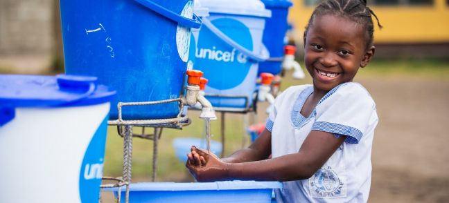 UNICEF/Tremeau A young girl washes her hands at a primary school in the Democratic Republic of the Congo.