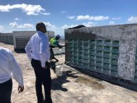 Minister De Weever looking at the on-going works at the House of Detention in Point Blanche.