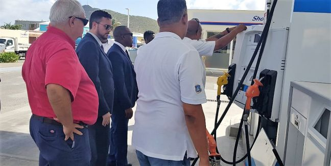 In the photo from the left are Sol Petroleum General Manager for the North Caribbean David Antrobus, Minister of TEATT the honorable Stuart Johnson, Member of Parliament for the National Alliance Egbert Jurendy Doran, and members of the Department of Inspection in the Ministry of TEATT at a Sol Gas Station inspecting the Gas Pumps to ensure that they are accurately calibrated for the dispensing of fuel.