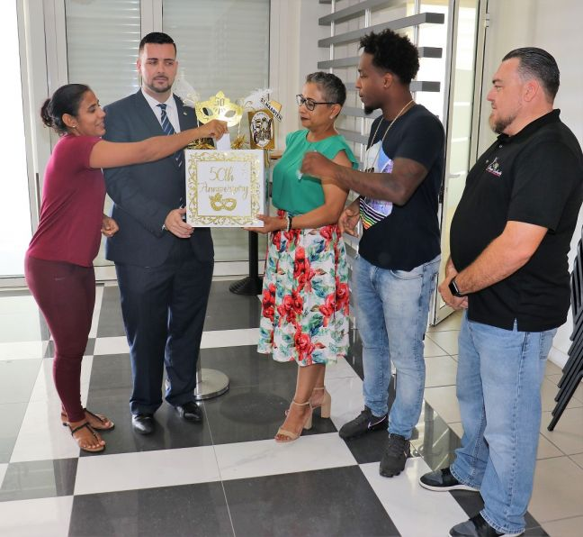 "First raffle participant Ms Maribel Postiena, TEATT Minister the Honourable Stuart Johnson, STB Interim Director May-Ling Chun, second raffle participant Mr Micheal Angelo ""Sponge"" and Always Enchanted representative Ronny Wever."