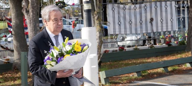 UN Photo/Mark Garten The UN Secretary-General, António Guterres, lays a wreath in Christchurch memory of the victims of a mass shooting in the New Zealand city in March 2019. (May 2019)