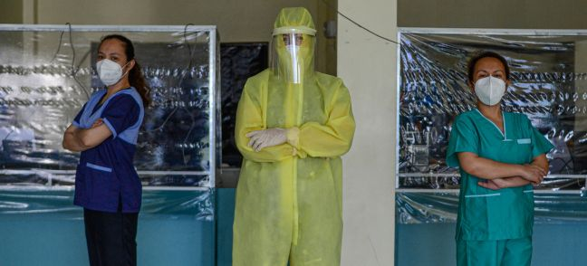 UN Women/Louie Pacardo Wearing a full protective suit, a women doctor who leads a group of volunteer medical professionals attending to COVID-19 patients and persons under investigation at a community hospital in the Philippines.