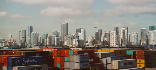 Unsplash/Jared Sanders Shipping containers at a port in Miami, USA.