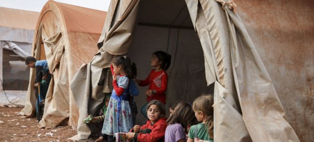 UNICEF/ Aaref Watad Girls sit in the tent of a makeshift camp in the north of Syria. 2018
