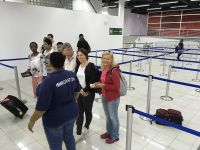 Passengers arrive for the first time in the arrival hall of SXM Airport Terminal Building on Tuesday.