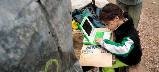 Young girl in Uruguay uses her laptop to study at home. UNDP Uruguay/Pablo La Rosa