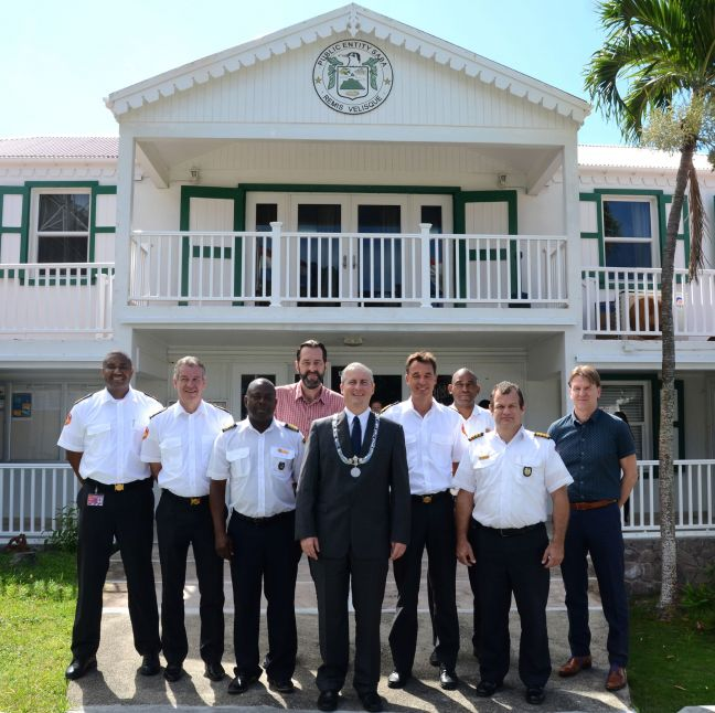 Fire chiefs of the Caribbean Netherlands, Aruba, Curaçao and St. Maarten, and representatives of the Netherlands Fire Department and St. Maarten's disaster management met with Island Governor Jonathan Johnson (center, front)