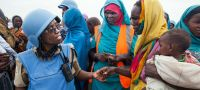 UN Photo/Albert Gonzlez Farran Tanzanian police officer Grace Ngassa (left), serving with the African Union-United Nations Hybrid Operation in Darfur (UNAMID), talks to a woman resident of Zam Zam camp for internally displaced persons (IDPs), near El Fasher, capital of North Darfur.