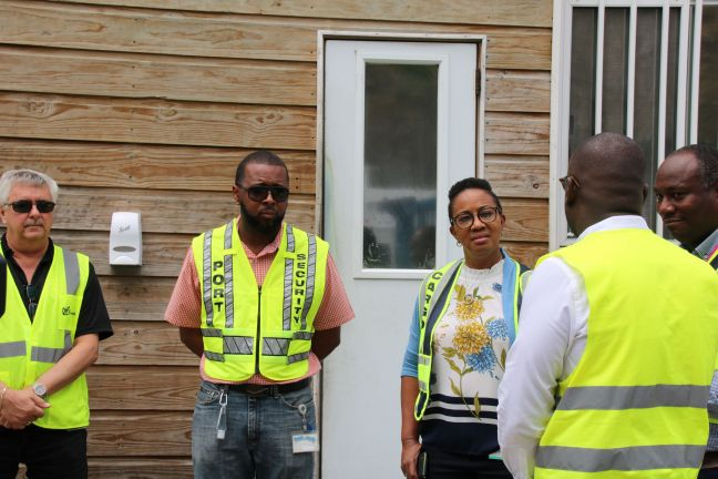 The Prime Minister Silveria Jacobs listening to Port St. Maarten officials explain the hygiene protocols that are in place.