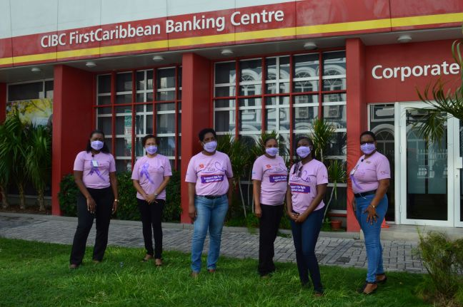 CIBC FirstCaribbean employees in Walk for the Cure shirts and face masks.