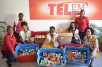 "TelEm Group workers proved themselves to be a generous lot when they added these non-perishable food items to the Leo Club ""T'is the Season"" food drive for the needy."