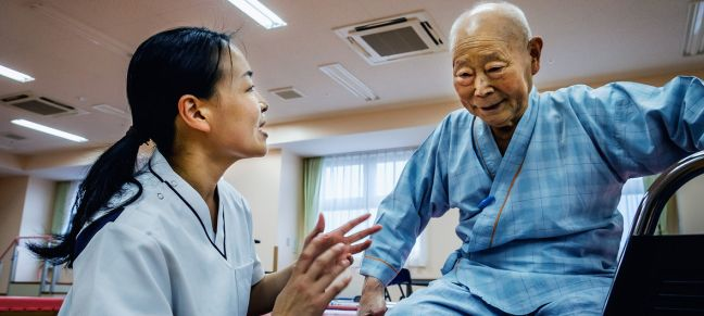WHO/Yoshi Shimizu An elderly patient receives rehabilitation care in Japan.