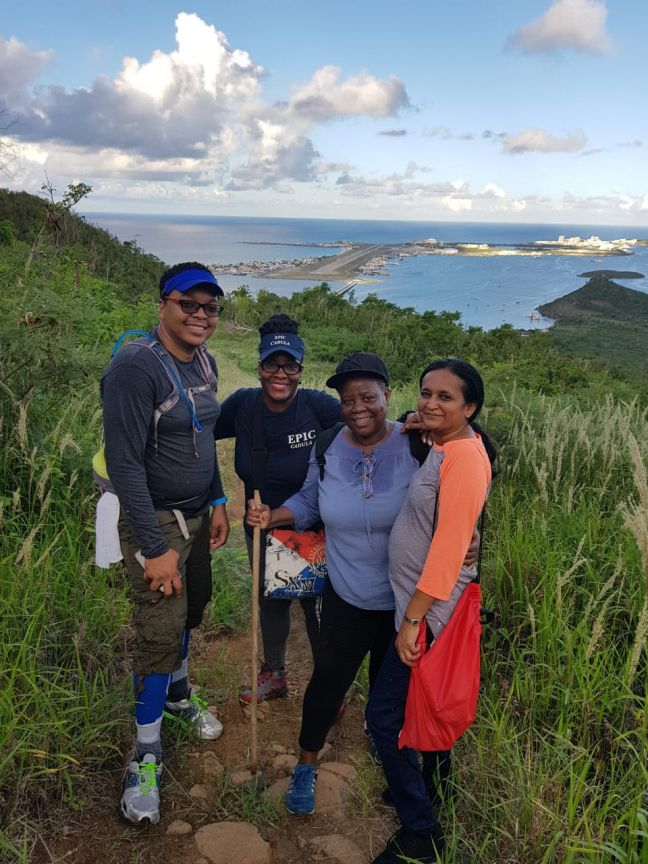 Project Coordinator Cadula Jones enjoys the view with hike participants.