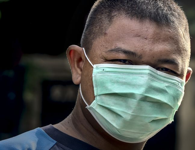 A person wearing a face mask to protect. (file photo)
