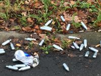 Laughing gas capsules dumped by the side of a road in Amsterdam. Photo: DutchNews