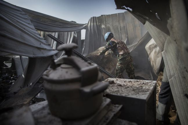 In Kidal, northern Malia, a UN peacekeeper searches for pieces of mortar shell in the damaged MINUSMA camp which was targeted by intensive mortar fire in an overnight attack on 8 June, 2017. UN Photo/Sylvain Liechti