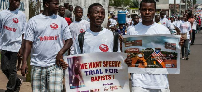 UNMIL/Staton Winter Liberian men march with anti-rape posters (file photo).