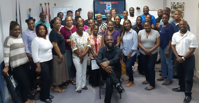Some of those who attended the workshop, with Facilitator Edsel Gumbs seated upfront and on the right is COCI Executive Director Anastacio Baker.