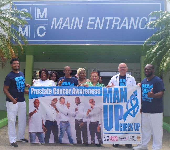 L to R: Nurses, Staff and patient of St. Maarten Medical Center, Mercedes Elektra van der Waals Wyatt - President Elektralyets Foundation, Shelly Alphonso President - Positive Foundation and Dr Ramos – Urologist at SMMC