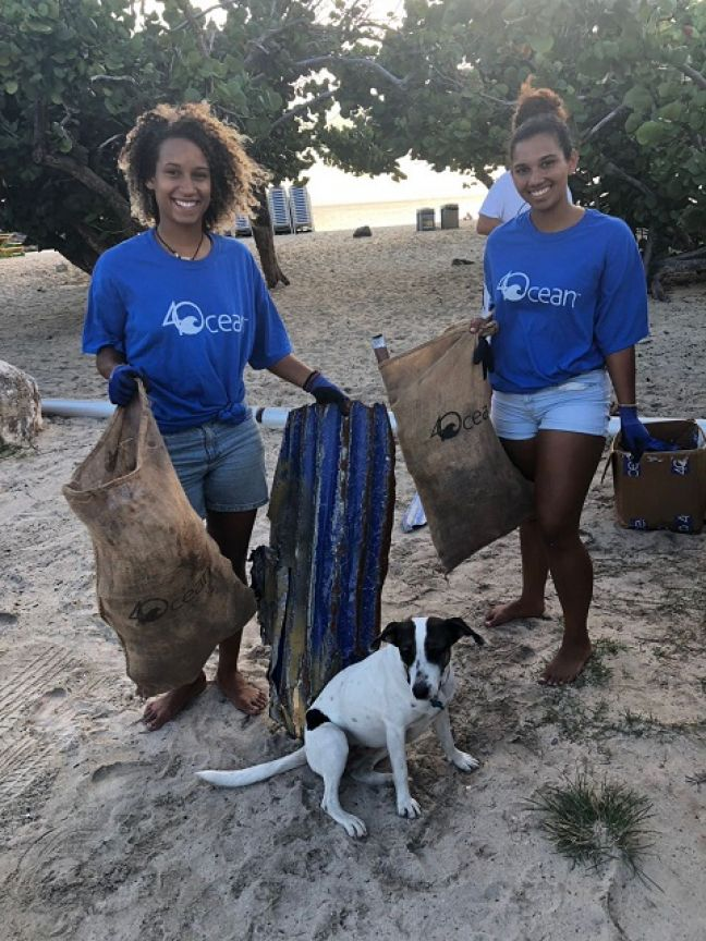 Nature Foundation Representatives Lynn Martina, Rebecca Benjamin-Carey and Binky the Beach Cleanup Dog Tracking Trash at the first Beach cleanup for the new 'Reduce & Reuse St Maarten' project!